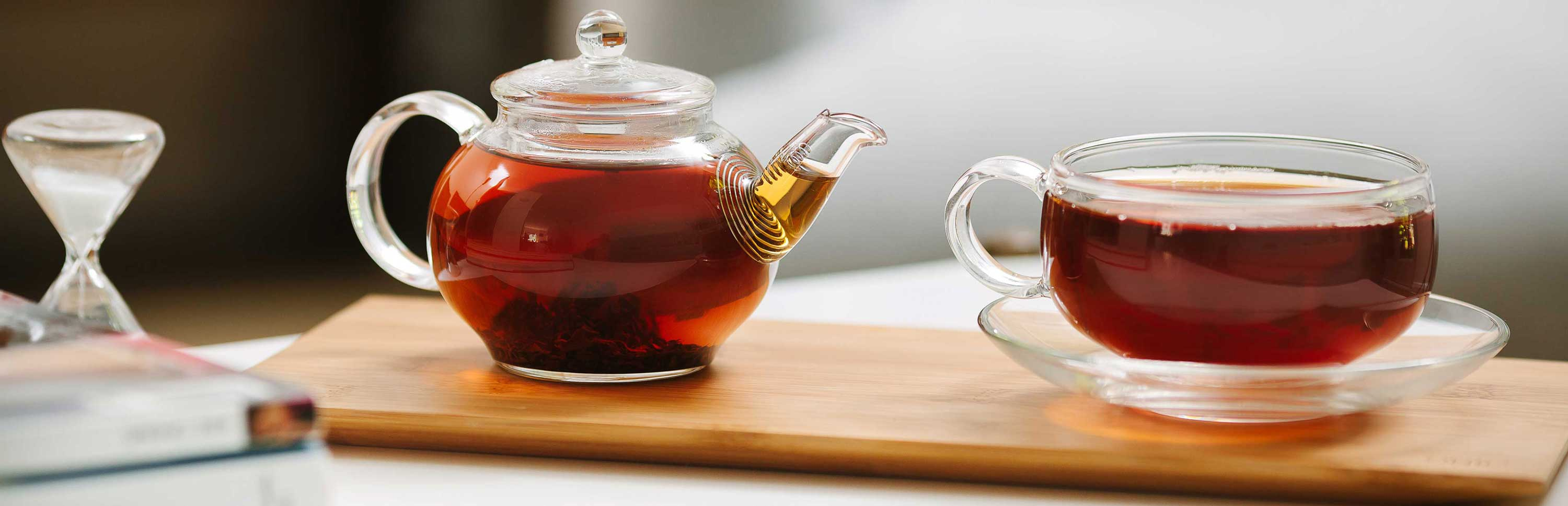 Glass Teapot on Bamboo Wooden Tray