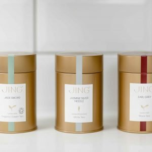 Three Assorted JING Tea Caddies on a Shelf