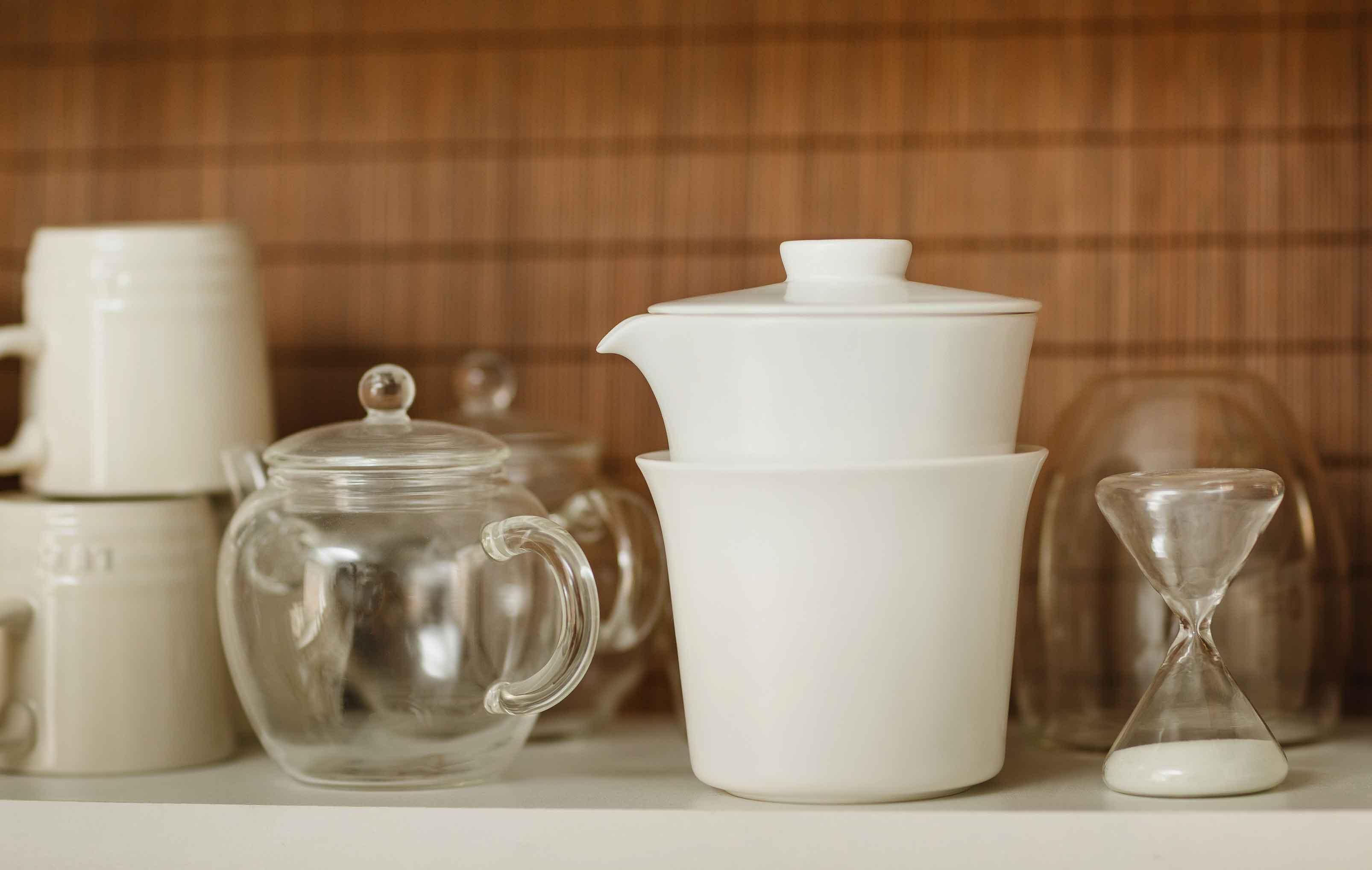 Assorted JING Teaware on a Shelf
