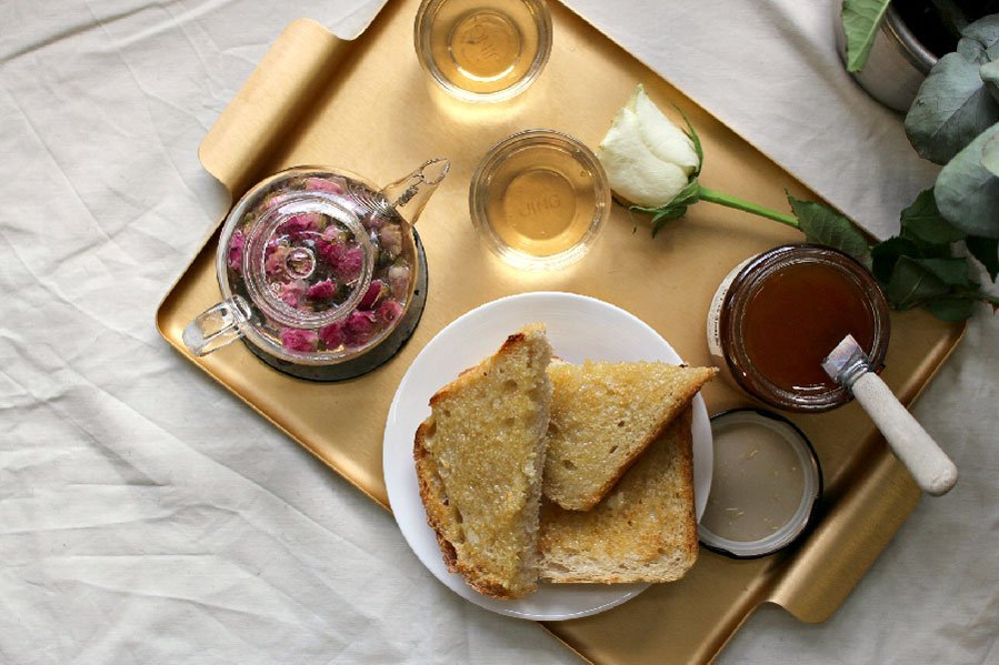 Toast and Jam on a Tray with JING Whole Rosebuds Infusion on a Gold Tray