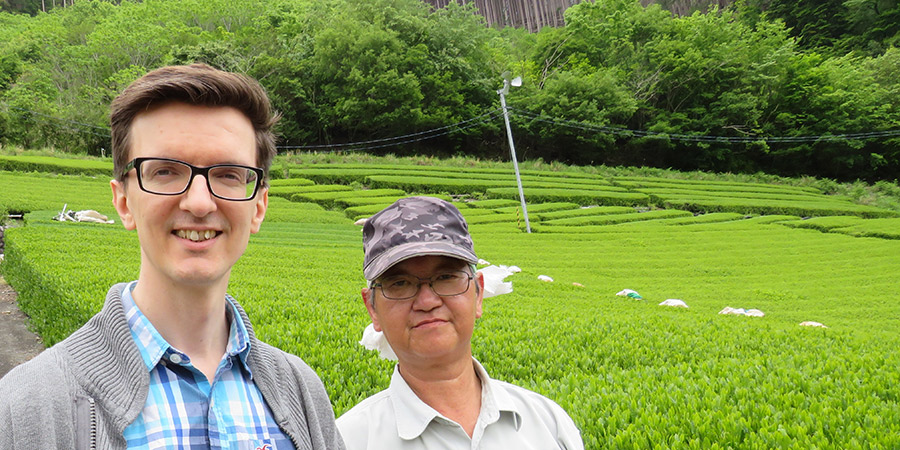 Tom, JING's Head of Tea, with farmer Yoshiro Okamura.