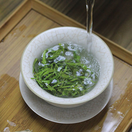 In China, spring green teas are often enjoyed using a traditional porcelain gaiwan to infuse the leaves