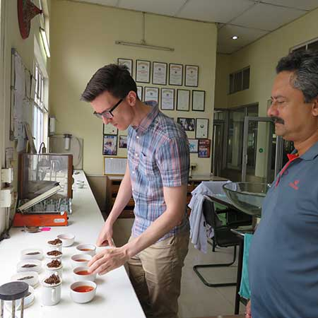 Tom & the garden manager tasting last year's second flush in the Harmutty tasting room.