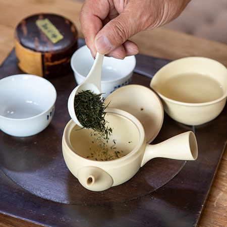 Ishiyama prepares his Sencha in the typical local style - a small clay kyusu pot and lots of short infusions in small cups