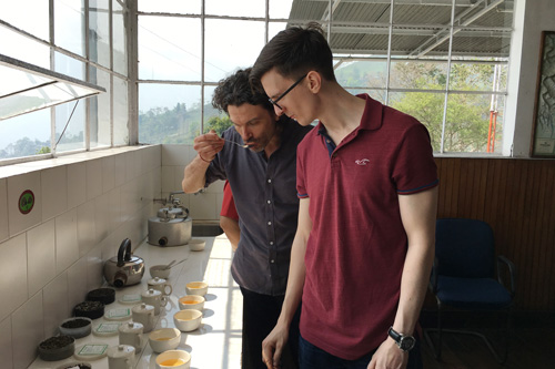Ed-and-Tom-taste-their-way-though-a-selection-of-freshly-made-teas-in-Darjeeling-on-a-sourcing-trip-a-few-years-ago