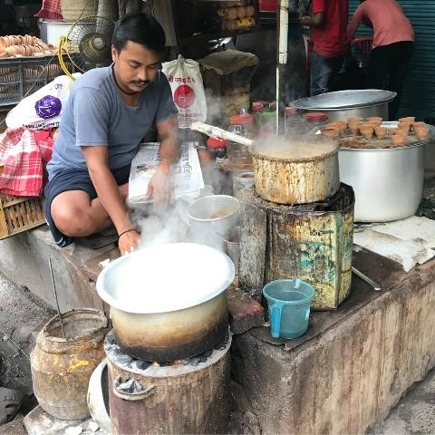 Masala Chai being made on the street in Kolkata - notice the small clay cups they use on the right hand side.