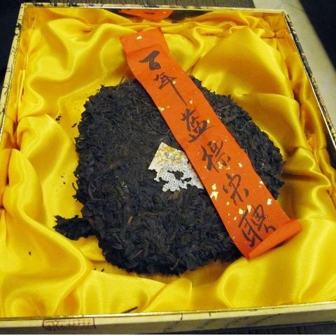This rare Song Pin Hao puerh cake has been aged for 100 years in Yunnan, making it extremely valuable.