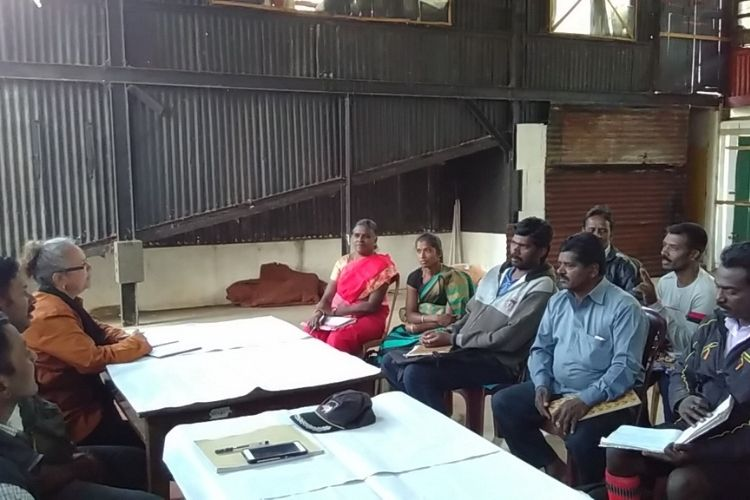 Sabita meets with tea workers at a Fairtrade Premium Committee meeting in India.