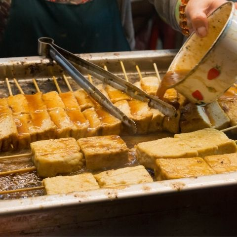 Stinky tofu being served at a street food market in Taipei.