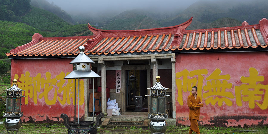 A small temple in the misty mountains.